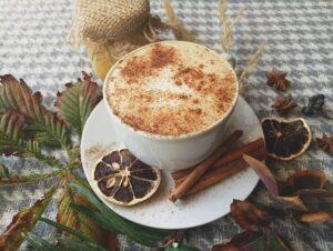 cinnamon sprinkled on coffee