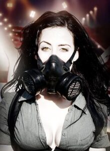 girl wearing gas mask because of environmental pollution