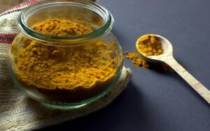 turmeric powder in glass jar