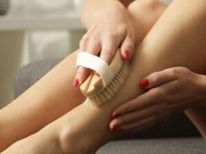 woman dry skin brushing