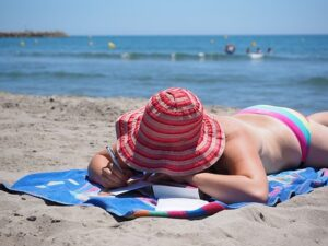 woman sunbathing on beach