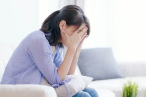 depressed woman on couch