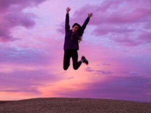 woman jumping for joy