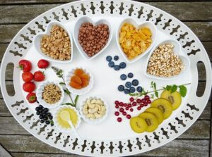 tray of healthy fruits, nuts, and pulses