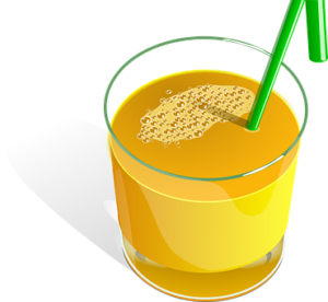 glass of orange juice with a green straw