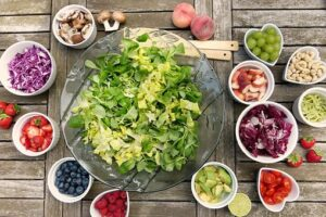 bowls of raw salad and vegetables