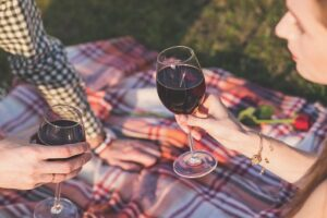 drinking wine at a picnic