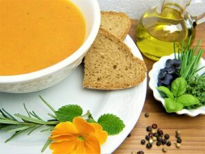 bowl of carrot soup with brown bread