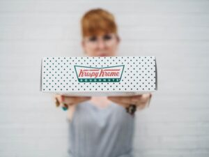 woman holding donuts