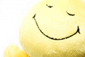 smiley face yellow pillow