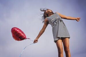woman with a heart shaped baloon