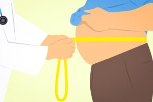 obese man with tape measure around his belly