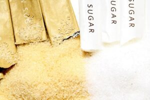 sachets of brown and white sugar