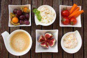 hummus, vegetable sticks, fresh figs, tomatoes