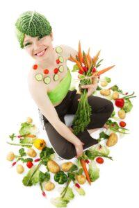 girl covered in vegetables
