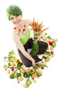 woman covered in vegetables