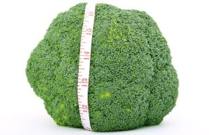 raw broccoli with tape measure
