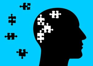 brain with pieces of the puzzle missing