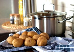 whole potatoes and boiling pot