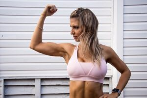 woman flexing her triceps