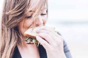 woman eating sandwich