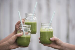 clear glasses of green smoothie