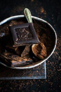 dak chocolate squares and cacao powder