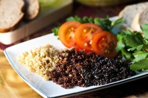 cooked red, white, and black quinoa
