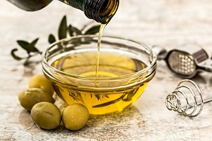 olive oil and fresh olives