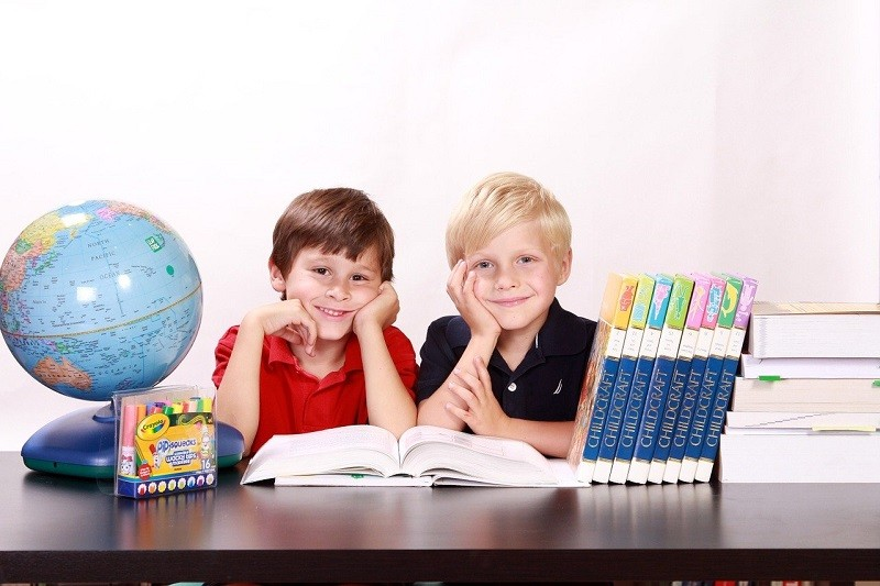 two boys with books